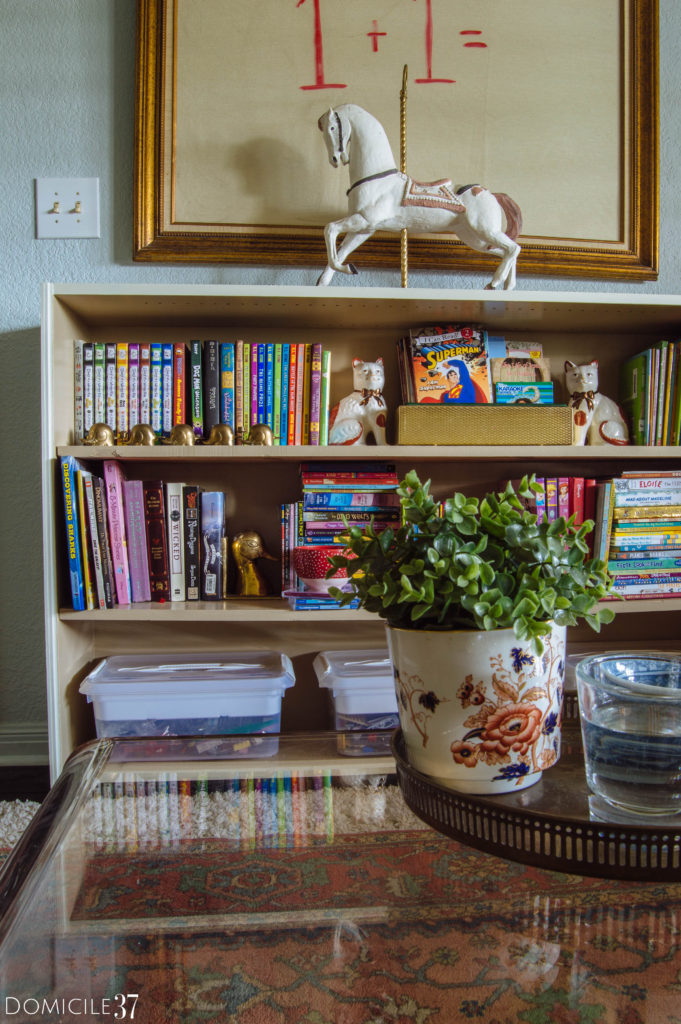 Colorful bookshelf styling for a sophisticated playroom